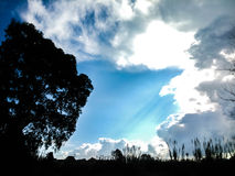 Clouds, sky and sun. In the suburbs of Corfu Stock Photos