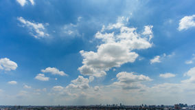 Clouds sky in Sunny day over the city Royalty Free Stock Photo
