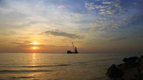 Clouds and sky before sunset at Bangpu seaside, gulf of thailand with Cargo ships sail past at evening times. Royalty Free Stock Images