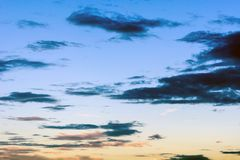 Clouds in the sky at sunset, illuminated by the sun`s rays royalty free stock photos