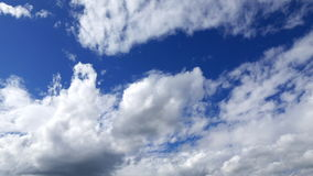 Clouds and sky Timelipse. Flow of Clouds in the Blue Sky. Majestic clouds illuminated by the sun. Timelipse stock video