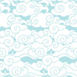 Clouds in the sky. Vector seamless pattern. Vector hand drawn background in white and blue colors Stock Image