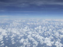 Clouds and sky, View on plane. Clouds and blue sky, View on plane Royalty Free Stock Image