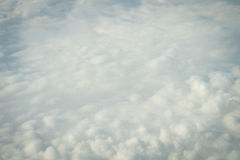 Clouds and sky view from a plane. Sky and clouds image taken form above while flying in a plane Royalty Free Stock Photos