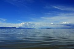 Clouds, sky, water, and mountains. Over the shimmering blue water of the Great Salt Lake near Syracuse, Utah Royalty Free Stock Photo