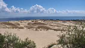Sand dune and Clouds  Royalty Free Stock Photos
