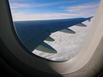 The clouds, sky and the wing Royalty Free Stock Photography