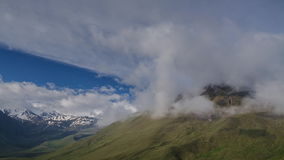 Clouds on the slopes of alpine mountains stock video
