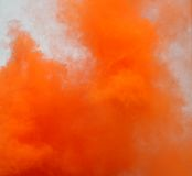 Clouds of smoke of a dangerous Orange smoke signal Stock Image