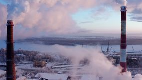 Clouds of smoke rise into the sky from pipe city boiler house. Aerial view. stock video footage