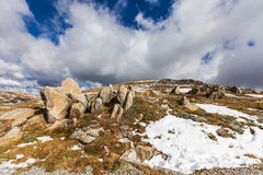 Clouds, snow, and rocks of Australian Alps. Royalty Free Stock Images