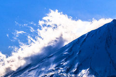 Clouds on the snow slope of Mount Fuji Stock Photos