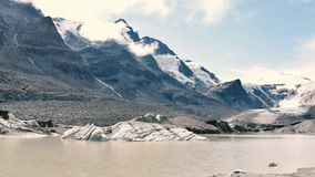 Clouds and snowbreak water moving in Grossglockner glacier in Alps stock footage