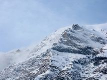 Clouds on the snowy peak. S during a windy day, Bardonecchia, Piedmont, Italy Royalty Free Stock Photo