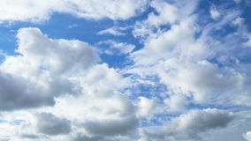 Clouds soar across the screen. Time lapse stock video