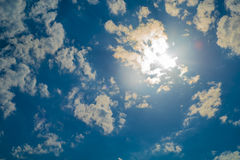 Clouds, solar flare and blue sky stock photos