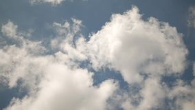 The clouds are spinning in a circle. The clouds and blue sky are spinning in a circle stock video footage