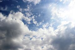 Clouds in the spring sky, all shades of blue. running in the sun clouds in the blue sky immediately after the rain. Selective focus stock images