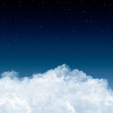 Clouds and stars in blue. A background with white clouds, blue sky and stars. Kind of an aerial view Stock Image
