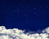 Clouds and stars in a night blue sky Stock Photos