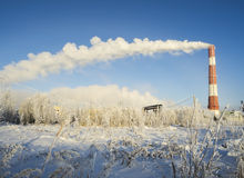 The clouds of steam coming from the chimney in winter . Stock Images