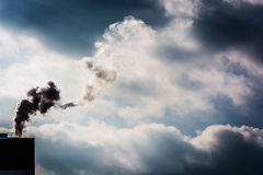 Clouds of steam from a paper mill in Spring Grove, Pennsylvania. Royalty Free Stock Image