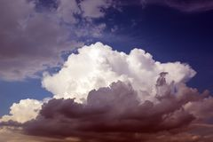 Clouds before the storm are approaching the clear sky royalty free stock photos