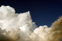 Clouds on stormy sky. White clouds in a stormy sky stock images