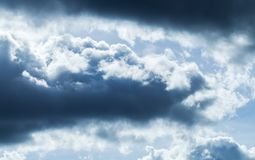 Clouds in stormy sky, natural background photo. Dark clouds in blue stormy sky, natural background photo stock photo