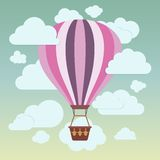 Clouds and striped hot air balloon on a blue. Background. Vector illustration Royalty Free Stock Images