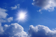 Clouds and sun. Sun and clouds against blue sky Stock Images
