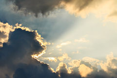 Clouds and sun beams Stock Images