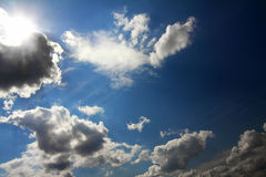 Clouds and sun on blue sky Royalty Free Stock Images