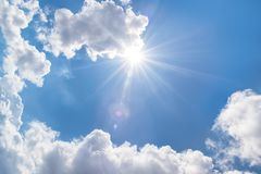 Clouds and sun in the blue sky stock image