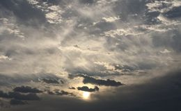 Clouds and Sun. Wlth a dark theme Stock Photography