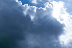 Clouds and sun flare. Background Royalty Free Stock Image
