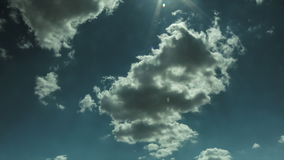 Clouds. With sun flare time lapse stock footage
