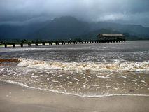 Clouds and sun at hanalei pier. A cloudy and sunny day at famous hanalei bay pier Stock Photo