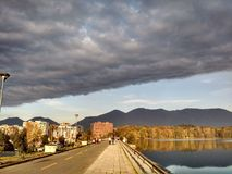 Clouds and sun over the artificial lake of Tirana stock photography