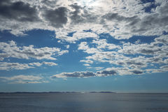 Clouds and sun over sea Royalty Free Stock Image