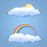 Clouds with sun and rainbow symbol  Royalty Free Stock Images