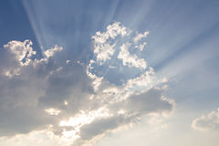 Clouds and sun ray on blue sky Royalty Free Stock Image