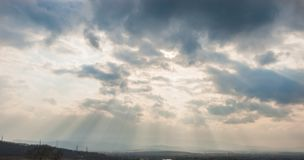 Sun ray. Clouds and sun ray on blue sky background Stock Photography