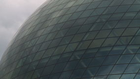 Clouds and sun reflections on modern sphere glass building stock video