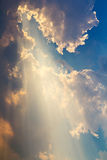 Clouds and sunbeam on blue sky Stock Images