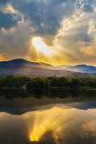 Clouds and sunbeam over mountain Stock Image
