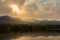 Clouds and sunbeam over mountain and lake.  royalty free stock photos