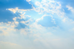 Clouds and sunbeam shining through. Clouds and a blue sky with a sunbeam shining through Royalty Free Stock Photos