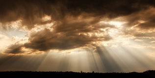 Clouds and sunbeams. Sun rays. Stock Images