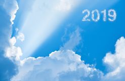 2019 among clouds and sunlight. 3D illustration stock images